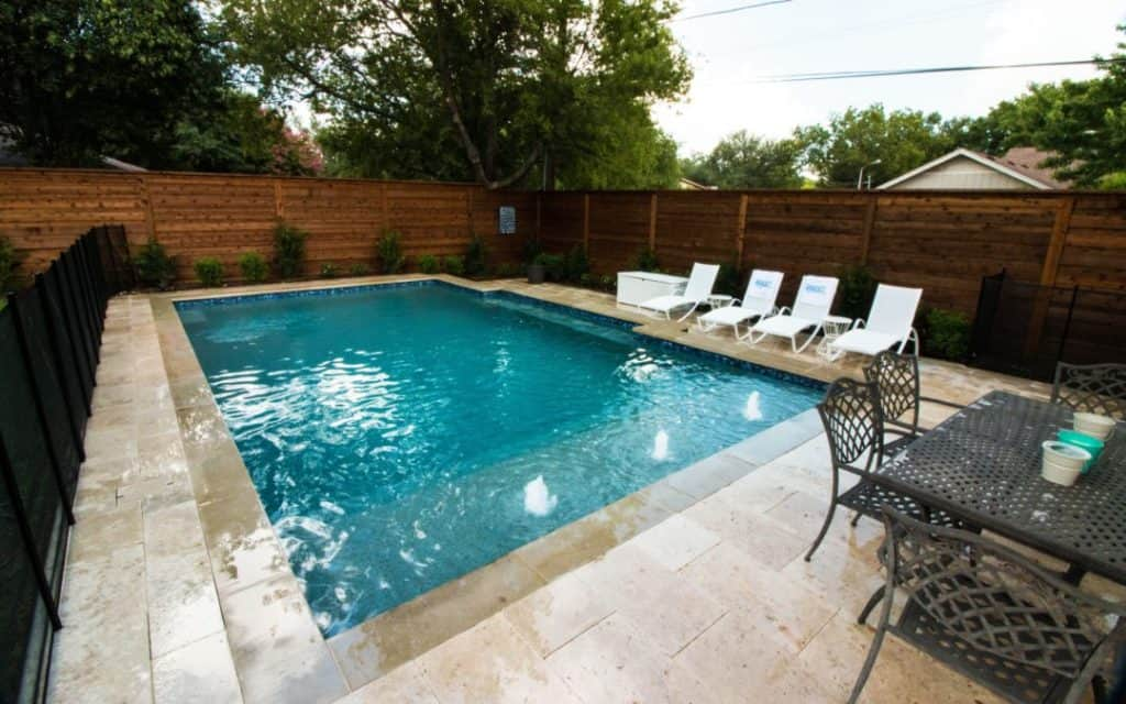 Backyard Swimming Pool With Splash Pad Summerhill Pools