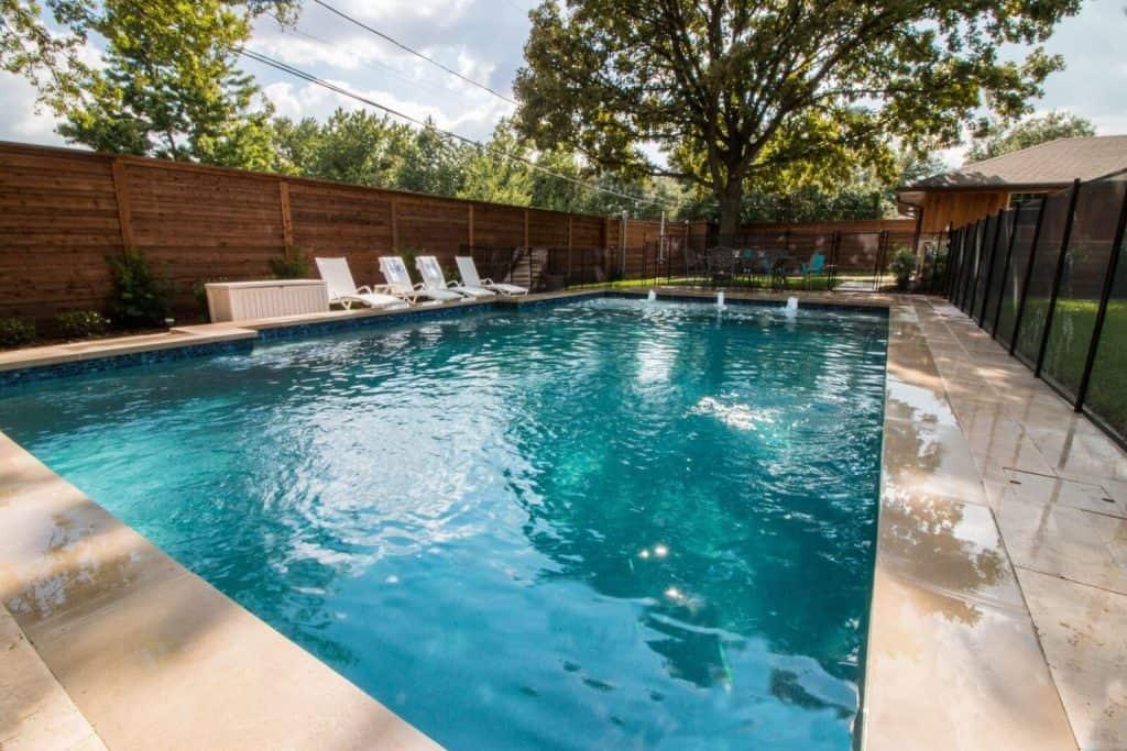 Backyard Pool with Splash Pad for Family Fun