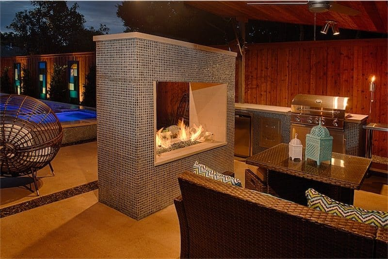 Free-standing fireplace surrounded by patio furniture