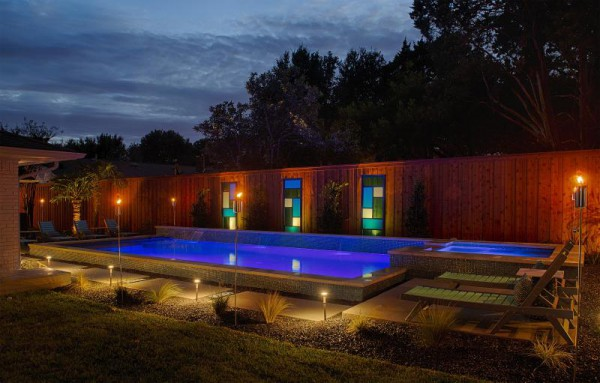 A pool at night lit from both the outside and the inside