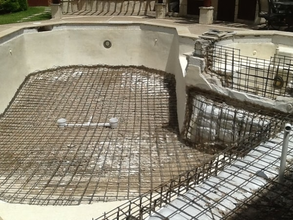 A pool in the middle of a remodel including a design change