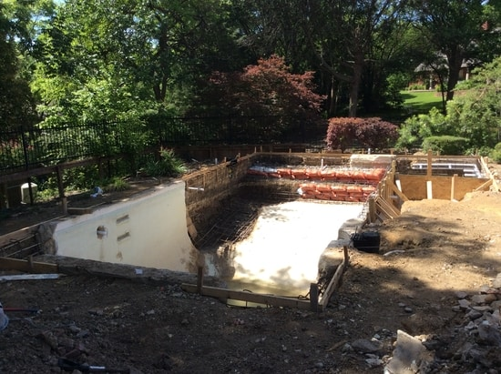 A pool under construction to increase in the size and depth