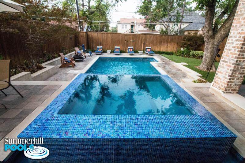 rectangle backyard pool with huge glass tile spa