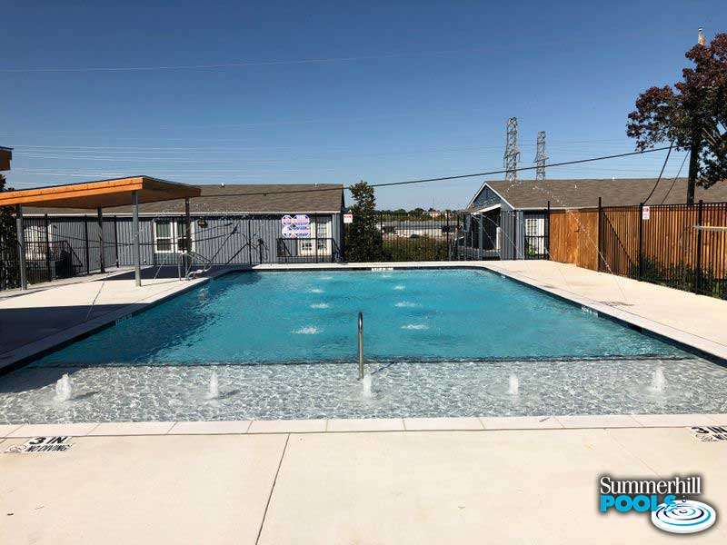 commercial pool with tanning ledge