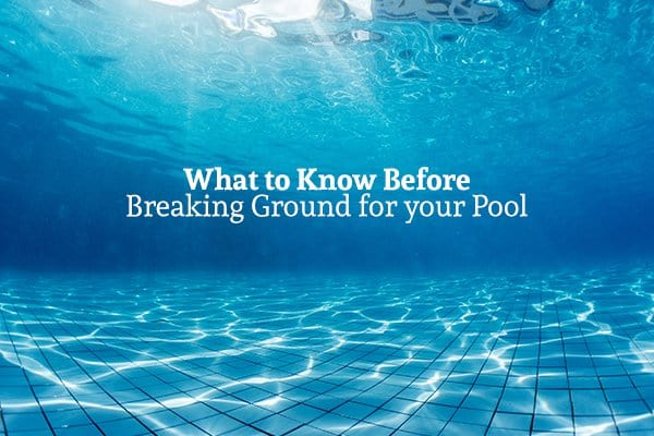 "A view from underwater in a pool with the words ""What to Know Before Breaking Ground for your Pool"""